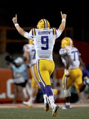 LSU quarterback Joe Burrow (9) celebrates a touchdown against Texas.