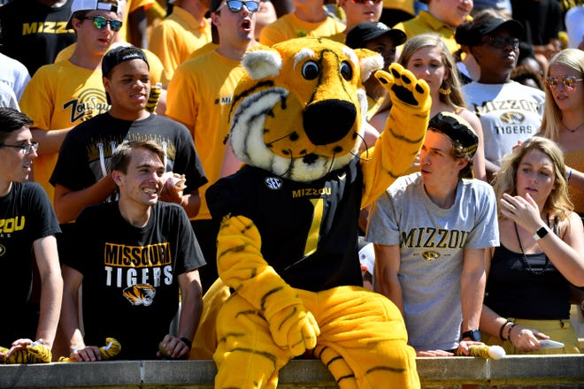 Missouri Tigers mascot Truman celebrates with fans during the second half against the West Virginia Mountaineers.