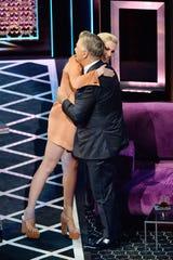 Ireland Baldwin hugs her dad onstage after roasting him at the Saban Theatre.