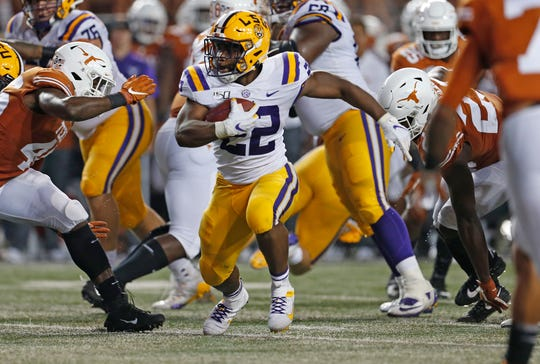 LSU running back Clyde Edwards-Helaire looks for running room against the Texas defense at Darrell K Royal-Texas Memorial Stadium.