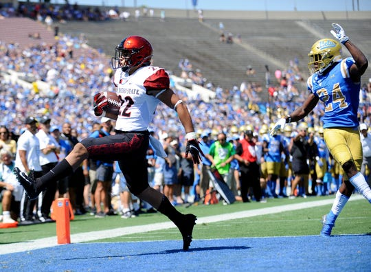 San Diego State running back Chase Jasmin scores a touchdown against UCLA during Saturday's game.