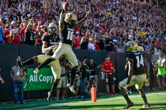Colorado wide receiver Tony Brown celebrates a fourth quarter touchdown reception with teammates during a game against the Nebraska Cornhuskers.