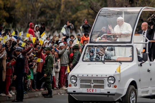 Pope Francis greets crowd as he arrives at the St. Michel complex in Antananarivo in Antananarivo, Madagascar, on September 8, 2019. - Pope Francis visit three-nation tour of Indian Ocean African countries hard hit by poverty, conflict and natural disaster.