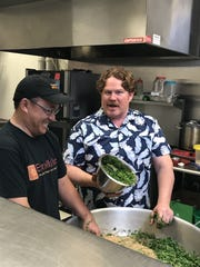 """Filming """"Man v. Food"""" in May with Eggrolls Inc. owner Blong Yang, left, and show host Casey Webb."""