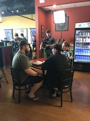 "Filming ""Man v. Food"" at Eggrolls Inc. with show host Casey Webb, at right in Hawaiian shirt."