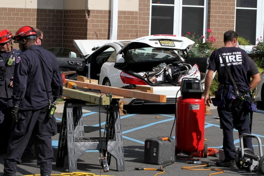 Asbury Park Firefighters prepare to add braces to Hesse Hall at Monmouth University in West Long Branch Monday afternoon, September 9, 2019, after it was struck by a car.