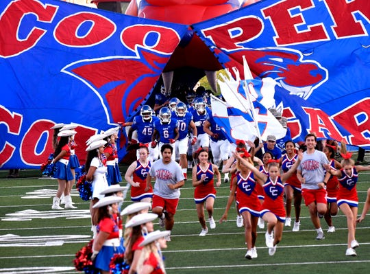 The Cooper Cougars football team takes to the field for their game against Grapevine on Sept. 6 at Shotwell Stadium. Cooper won 42-14 to improve to 2-0 to start the season.