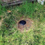 A replaced water meter with an external antenna that sends real-time data.