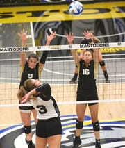 Former Harper Creek standout Charley Andrews, right, recently earned all-tournament honors for Western Michigan University in volleyball.