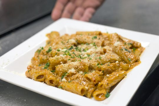 Lost Dog Cafe's signature dish, the addictive Rigatoni Ala Vodka.