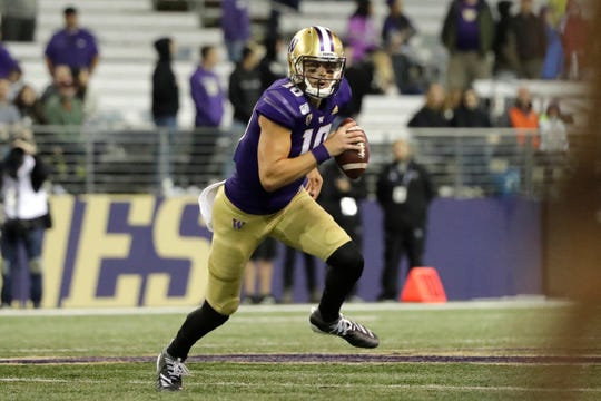 Washington quarterback Jacob Eason scrambles against California during the second half of an NCAA college football game, Sunday, Sept. 8, 2019, in Seattle. California won 20-19.