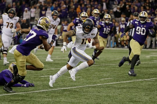 California wide receiver Kekoa Crawford (11) runs the ball against Washington during the second half of an NCAA college football game in the early morning hours of Sunday, Sept. 8, 2019, in Seattle. California won 20-19.