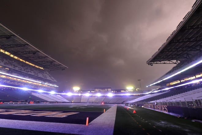 Lightning lights up clouds above Husky Stadium during a weather delay in the first quarter of an NCAA college football game between Washington and California, Saturday, Sept. 7, 2019, in Seattle. Fans were directed to seek shelter in nearby buildings due to severe weather in the area.