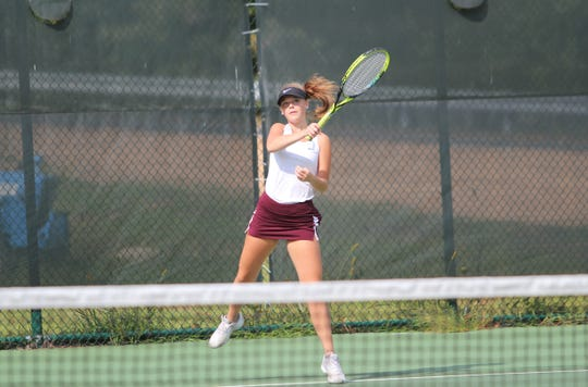 Summer Thoma follows through on a return as she wins her match against Smoky Mountain on Sept. 5. The senior is one of two captains for the Warlassies tennis team.