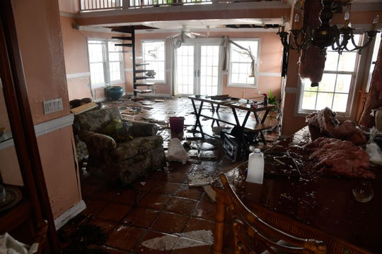 Inside the battered house where John Slack, his wife and friends were, during Hurricane Dorian. The house is near Treasure Cay Marina and Golf Resort.
