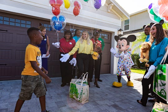 Jermaine Bell gets the surprise of a lifetime upon seeing Mickey Mouse at his birthday party Sunday.