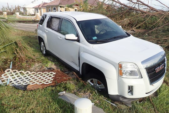 John Slack, his wife, two other adults, a 4-year-old and three dogs rode out the brunt of Hurricane Dorian inside this white SUV near Treasure Cay in the Bahamas. Notice the rear passenger window has an air bag covering it. Slack used that air bag to ward off the storm after a 2x6 broke the window.