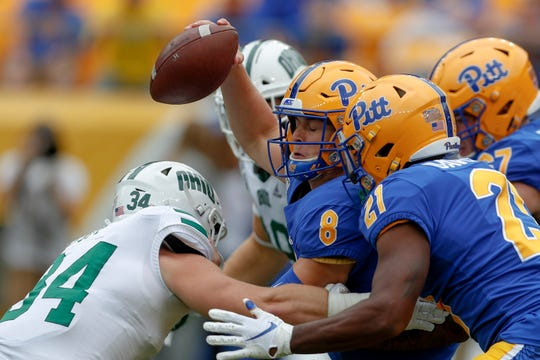Pittsburgh quarterback Kenny Pickett (8) is hit by Ohio linebacker Eric Popp (34) during the first half of an NCAA college football game, Saturday, Sept. 7, 2019, in Pittsburgh.