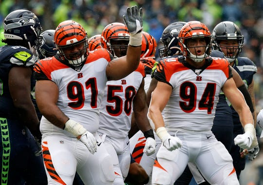 Cincinnati Bengals defensive end Sam Hubbard (94) celebrates after sacking Seattle Seahawks quarterback Russell Wilson (3) in the third quarter of the NFL Week 1 game between the Seattle Seahawks and the Cincinnati Bengals at CenturyLink Field in Seattle on Sunday, Sept. 8, 2019. The Bengals lost 21-20 in the season opener.