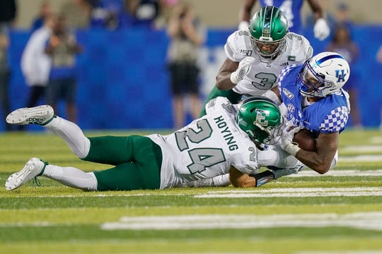 Kentucky running back Asim Rose (10) is tackled by Eastern Michigan defensive back Brody Hoying (24) and defensive back Vince Calhoun (3) during the second half of an NCAA college football game, Saturday, Sept. 7, 2019, in Lexington, Ky.