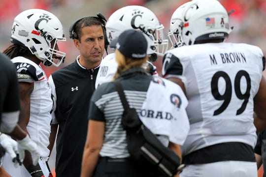Cincinnati Bearcats head coach Luke Fickell talks in a huddle during a college football game against the Ohio State Buckeyes, Saturday, Sept. 7, 2019, at Ohio Stadium in Columbus.