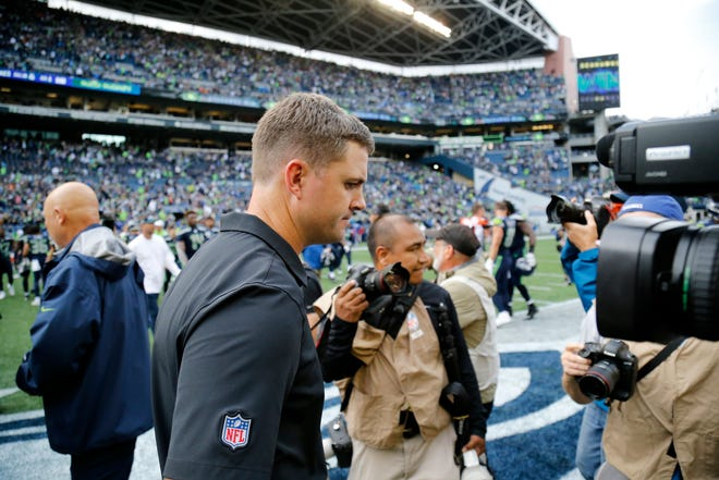 Cincinnati Bengals head coach Zac Taylor heads for the locker room after shaking hands with Seattle Seahawks head coach Pete Carroll after the fourth quarter of the NFL Week 1 game between the Seattle Seahawks and the Cincinnati Bengals at CenturyLink Field in Seattle on Sunday, Sept. 8, 2019. The Bengals lost 21-20 in the season opener.