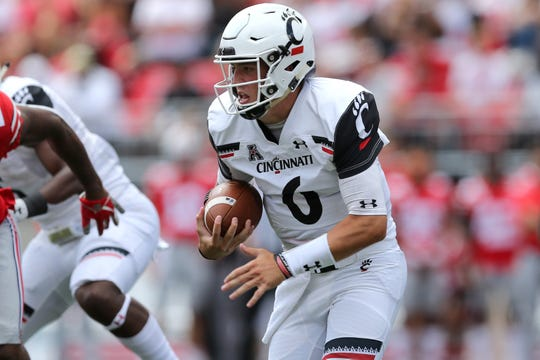 Cincinnati Bearcats quarterback Ben Bryant (6) carries the ball in the fourth quarter of a college football game against the Ohio State Buckeyes, Saturday, Sept. 7, 2019, at Ohio Stadium in Columbus. The Ohio State Buckeyes won 42-0.