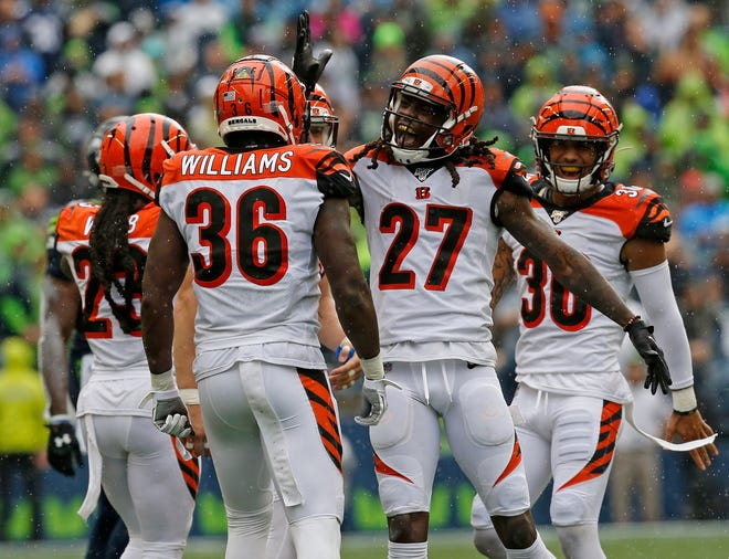 Cincinnati Bengals cornerback Dre Kirkpatrick (27) celebrates a sack in the third quarter of the NFL Week 1 game between the Seattle Seahawks and the Cincinnati Bengals at CenturyLink Field in Seattle on Sunday, Sept. 8, 2019. The Bengals lost 21-20 in the season opener.