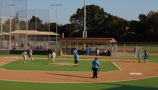 Members of the Buddy Ball team try out one of the new fields at the expanded Civitan Park on Friday, Sept. 6, 2019.