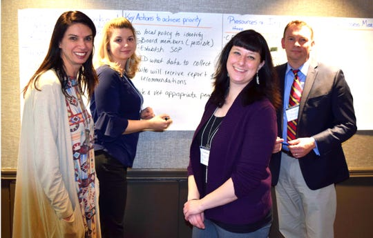 Several members of the Clarksville Suicide Prevention Coalition -- Kara Merriam, Centerstone; Misty Leitsch, TSPN; Carrie Brensike, TN Valley VA; and Joey Smith, County Health Director -- work to plan #BeThere Clarksville, a suicide prevention summit from 9 a.m. to 2 p.m. Oct. 3 at the Wilma Rudolph Events Center.