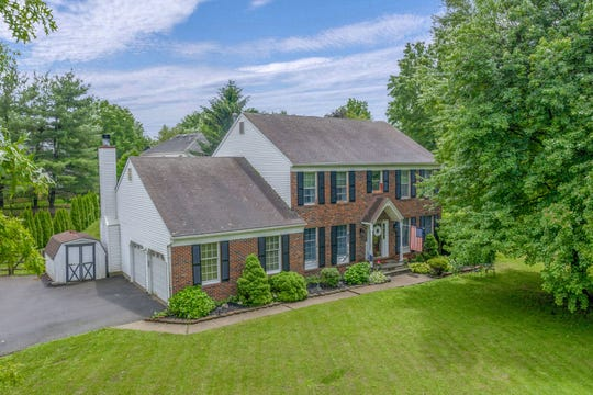 A brick front Colonial sited on 0.47-acre landscaped property at Fairway Estates in Warren County's Washington Township is for sale for $359,800.