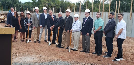 State Sen. Kip Bateman, Freeholder Brian Gallagher and Somerville Mayor Dennis Sullivan joined other local officials and representatives of DGM for the official groundbreaking of the Station House.