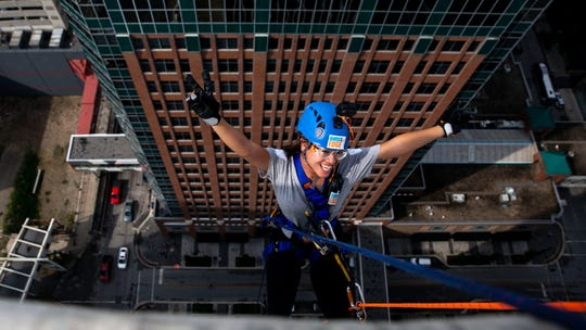 The Des Moines Register's Linh Ta rappels down the side of the Financial Center in downtown Des Moines during the Special Olympics of Iowa Over the Edge preview on Monday, Sept. 9, 2019. Over the Edge is an annual fundraiser for Special Olympics, participants who have raised $1,000 will rappel tomorrow.