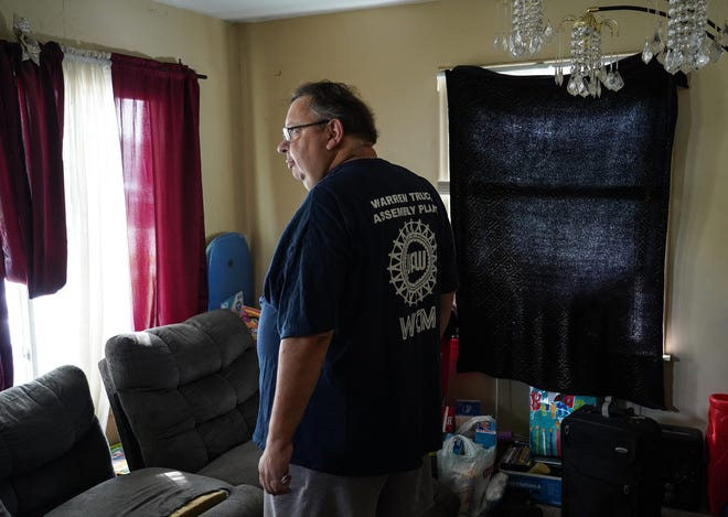 UAW worker Kenneth Mefford stands in the living room of his home in Warren on Friday, Sept. 6, 2019. Mefford remembers getting the Fiat Chrysler contract deal in 2015, one minute before midnight when it was due to expire and workers were prepared to walk off the line and strike.