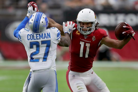 Cardinals receiver Larry Fitzgerald tries to elude Lions cornerback Justin Coleman after the catch during the second half of the Lions' 27-27 tie with the Cardinals on Sunday, Sept. 8, 2019, in Glendale, Arizona.