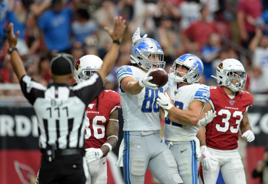 Lions tight end T.J. Hockenson, center, celebrates his touchdown with Danny Amendola during the second half of the Lions' 27-27 tie with the Cardinals on Sunday, Sept. 8, 2019, in Glendale, Arizona.