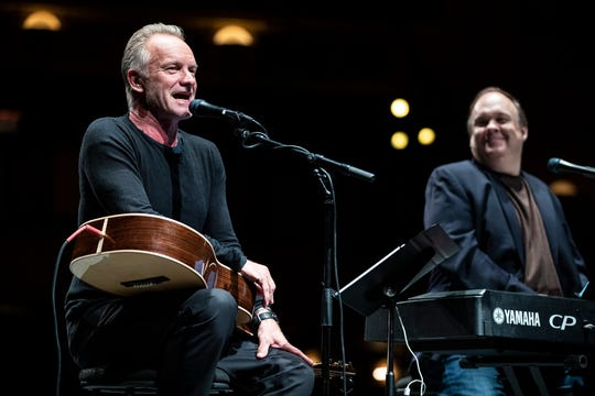 """Sting, left, performs next to Rob Mathes at the Detroit Opera House in downtown Detroit on Monday. He was at the Opera House as part of a promotional event for the musical """"The Last Ship,"""" which will be at the Opera House in April."""