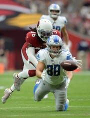 Detroit Lions tight end T.J. Hockenson is unable to make a catch against Arizona Cardinals safety D.J. Swearinger during the first half Sunday, Sept. 8, 2019, in Glendale, Ariz.