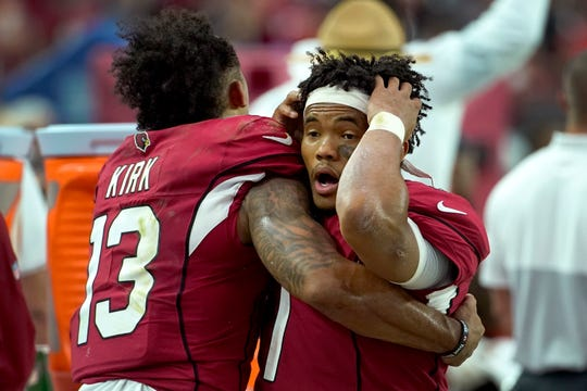 Cardinals quarterback Kyler Murray reacts with receiver Christian Kirk during the final seconds of the 27-27 tie with the Lions on Sunday, Sept. 8, 2019, in Glendale, Arizona.
