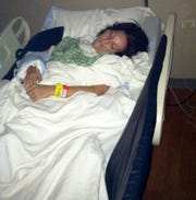 In this 2014 photo, Kaylee Hardenbrook was hospitalized and in a coma as her body fought Eastern equine encephalitis.