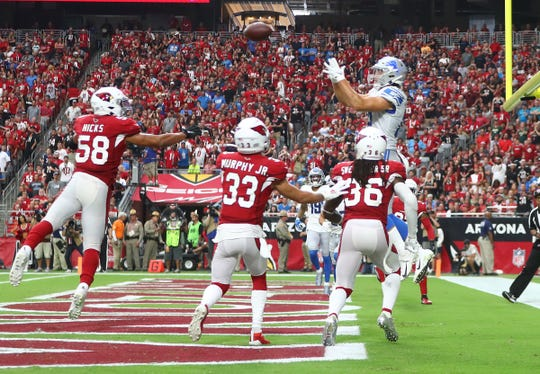 Lions tight end T.J. Hockenson catches a touchdown pass in the fourth quarter of the Lions' 27-27 tie with the Cardinals on Sunday, Sept. 8, 2019, in Glendale, Arizona.