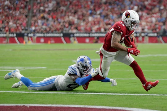 Cardinals receiver Christian Kirk scores a two-point conversion to tie the game as Lions defensive back Tracy Walker defends during the fourth quarter Sunday, Sept. 8, 2019, in Glendale, Arizona.