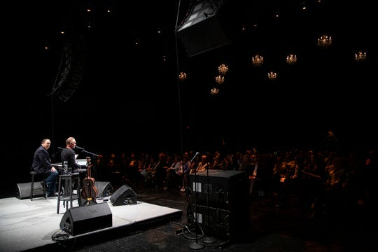 """Sting performs next to Rob Mathes at the Detroit Opera House on Monday. His musical """"The Last Ship"""" will be at the Opera House in April."""