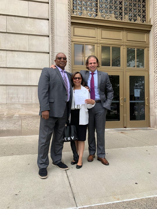A jury awarded $11.4 million to former prison deputy warden Cedric Griffey (left) and his wife Lisa, shown here with their attorney Jonathan Marko