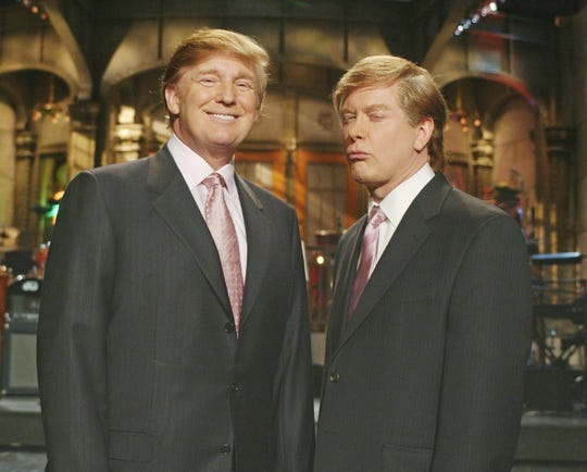 "Donald Trump, left, star of ""The Apprentice,"" joins Saturday Night Live's Darrell Hammond, who is in character as Trump, as they shoot promo spots for this Saturday's edition of NBC's ""Saturday Night Live,"" in New York, Thursday, April 1, 2004. Trump will host the live telecast Saturday, April 3. (AP Photo/NBC, Mary Ellen Matthews)"