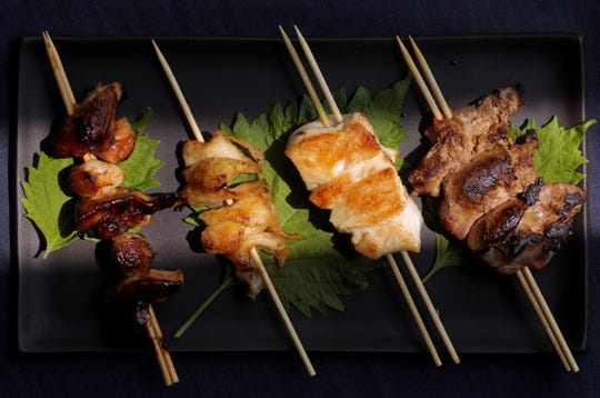 Yakitori (or chicken on a skewer) versions, left to right, tare style, torikawa, with shio (or salt) and reba (or livers). (Christian Gooden/St. Louis Post-Dispatch/TNS)