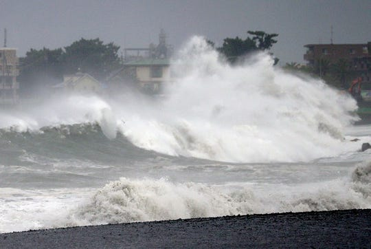 In this Sept. 8, 2019, photo, a high wave hits beach as typhoon approaches in Shizuoka city, central Japan.