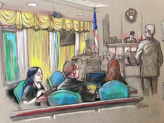 In this April 15, 2019, file court sketch, Yujing Zhang, left, a Chinese woman charged with lying to illegally enter President Donald Trump's Mar-a-Lago club, listens to a hearing before Magistrate Judge William Matthewman in West Palm Beach, Fla. Zhang, 33, who is accused of trespassing at Trump's Mar-a-Lago club and lying to Secret Service agents will be tried by a jury after frustrating the federal judge hearing her case.