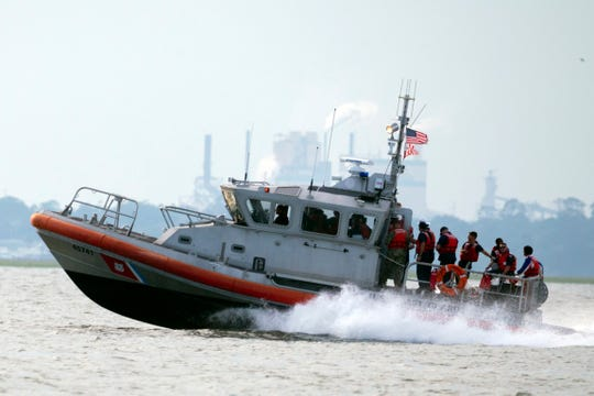 A United States Coast Guard vessel heads back to base with several members of the rescue team aboard after the last crew member was reportedly removed safely from the capsizes cargo shop Golden Ray on Monday.