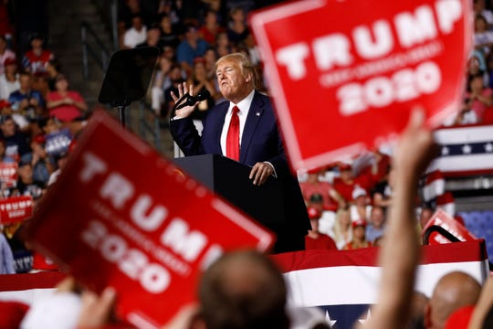 In this Aug. 15, 2019 photo, President Donald Trump speaks at a campaign rally, Thursday, Aug. 15, 2019, in Manchester, N.H.